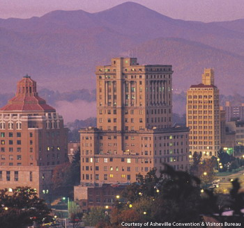 A photo of the cityscape of Asheville, North Carolina with the mountains as a background